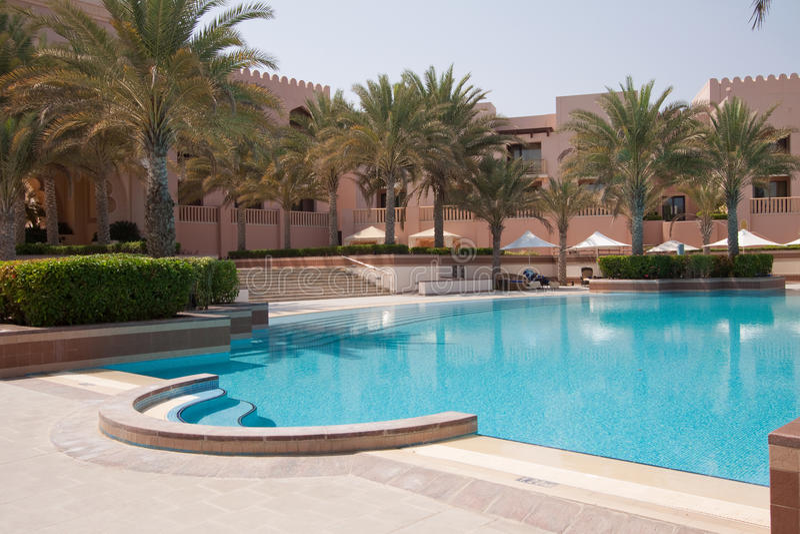Shangri-La Al Husn Swimming Pool. The swimming pool at the six-star Shangri-la Al Husn hotel in Muscat, Oman stock photo