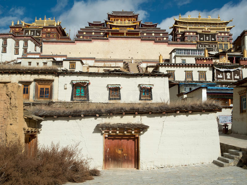 Shangri-La, China. Monastery Ganden Sumtseling Gompa with old town royalty free stock photos