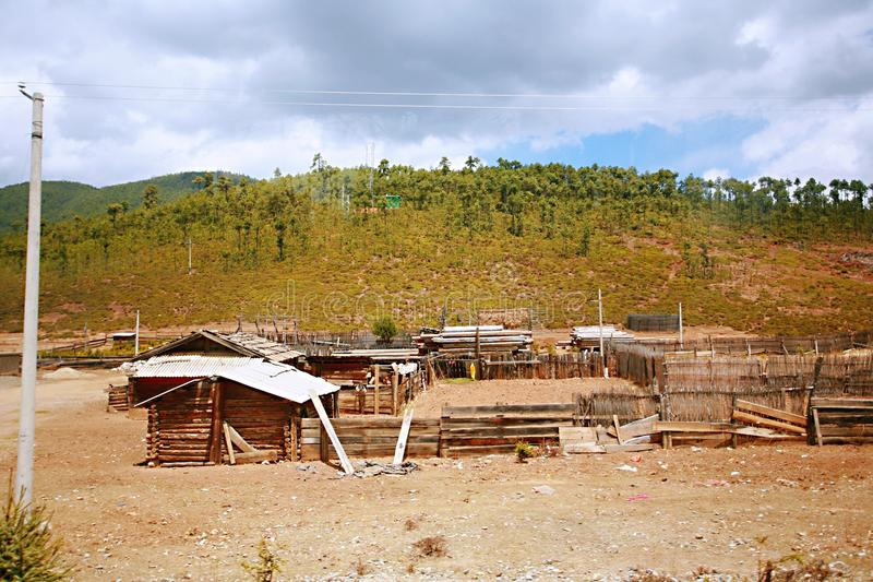 Shangri-La. Pasture and captive cattle and sheep shed in Shangri-La, Yunnan royalty free stock photo