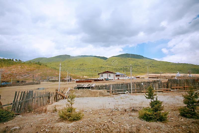 Shangri-La. Pasture and captive cattle and sheep shed in Shangri-La, Yunnan royalty free stock photography