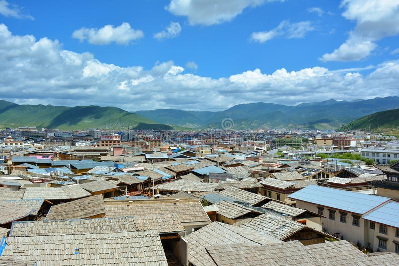 Shangri-La Zhongdian city, Yunnan province, China. Wooden roofs of the tibetian houses on the foreground royalty free stock photos