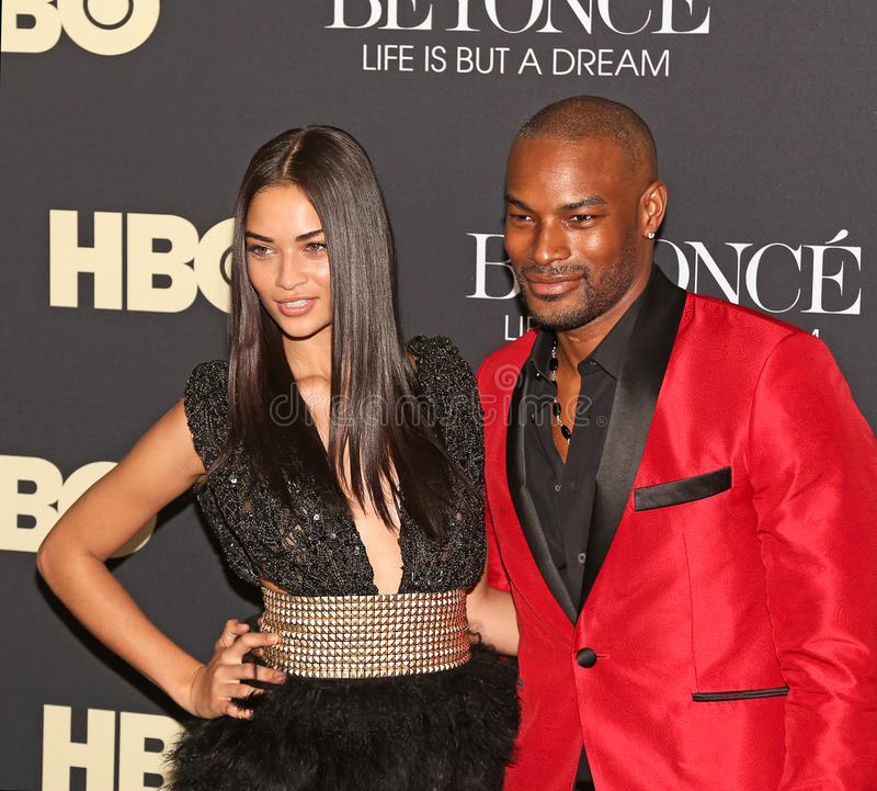 Shanina Shaik and Tyson Beckford. Australian model Shanina Shaik and model/actor Tyson Beckford arrive on the red carpet for the New York premiere of the HBO stock image