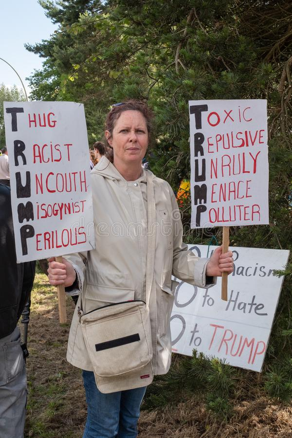 Shannon, Ireland, June. 5, 2019: A lady protesting against the Donald Trump visit with signs at Shannon Airport, Ireland at stock photo