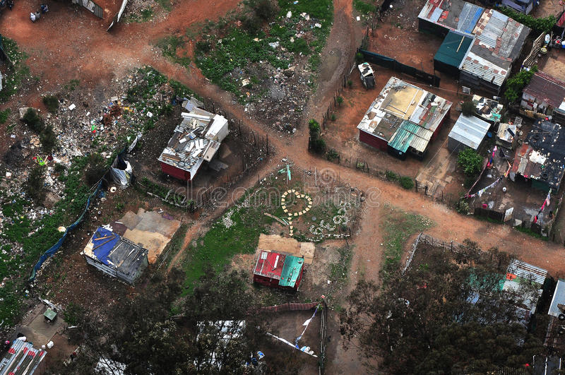 Shanty Town. Aerial view of an impoverished area, shanty town or informal settlement. One home owner has laid stepping stones in the shape of a heart in his stock image