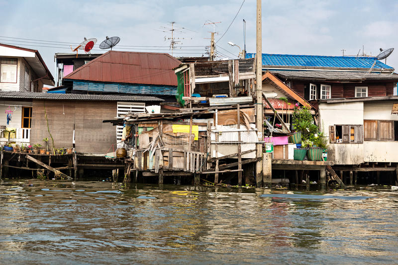 Shanty-town in Thailand. Shanty-town on dirty river (Thailand royalty free stock photography