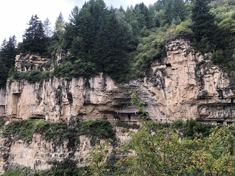 Shanxi Province Luyashan Cliff Hiking Trail. Shanxi Province Cliff Hiking Trail with a temple built inside of the mountain stock images