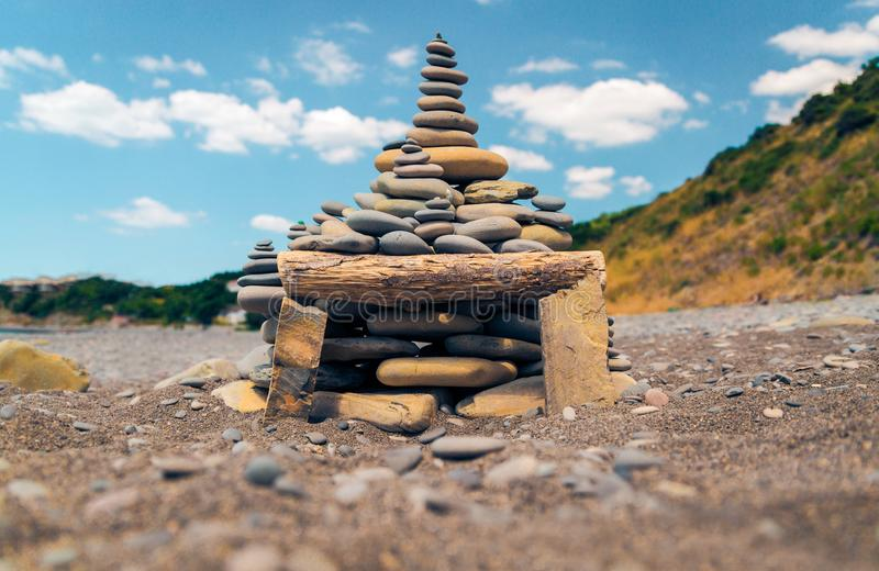 The shape of the colored stones on the seashore day in the sun o. N a blue sky background stock photography