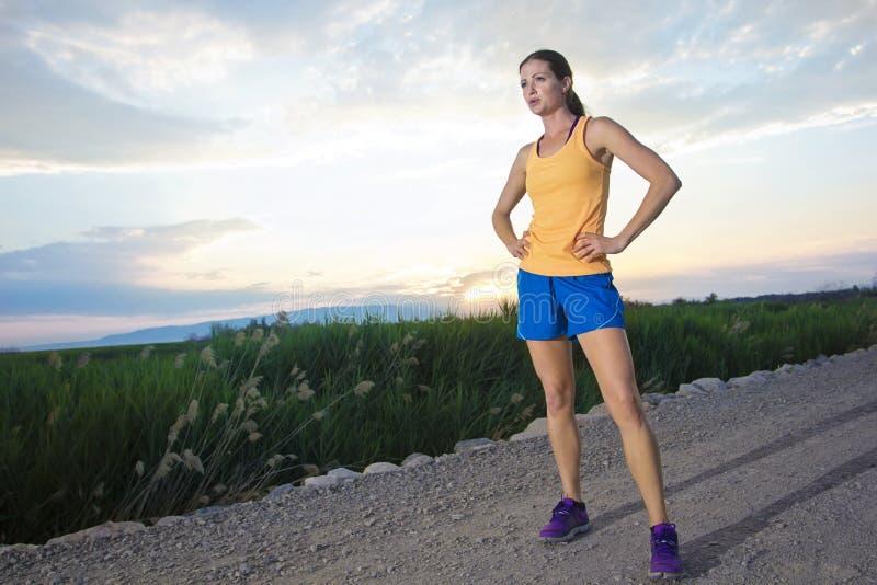 In Shape female Runner at Sunrise royalty free stock photo