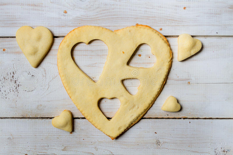 Shape of heart baked in a sweet cookie royalty free stock images