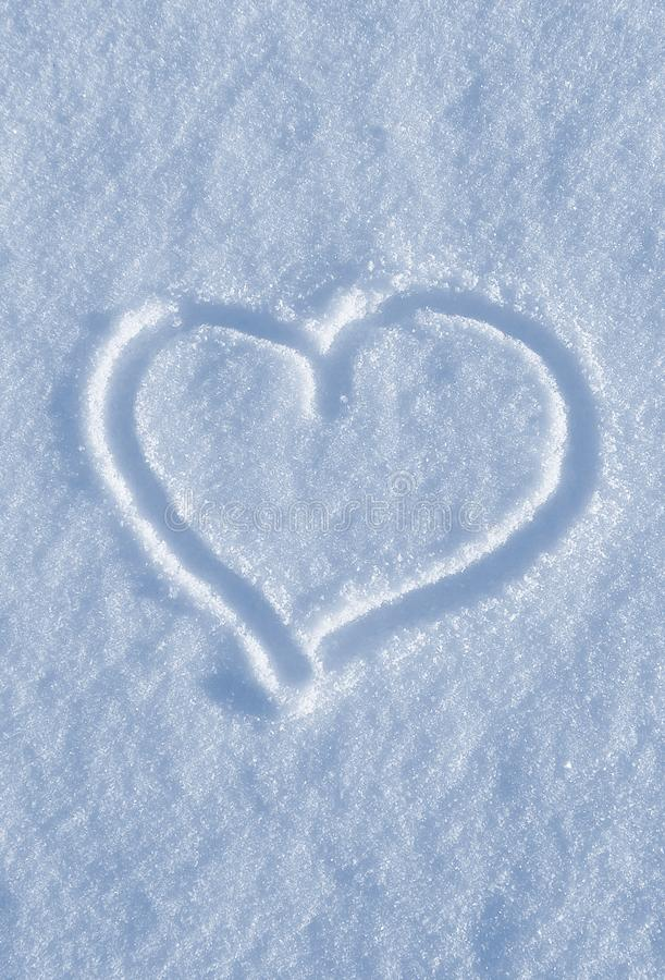 Draw of heart on the white snow. The shape of heart drawing on the white snow royalty free stock images