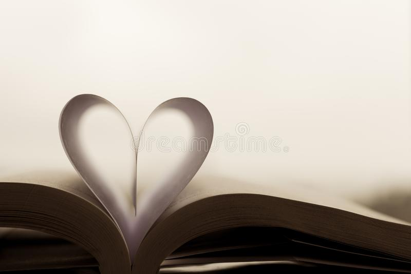 Heart-shaped paper inside a book. royalty free stock images