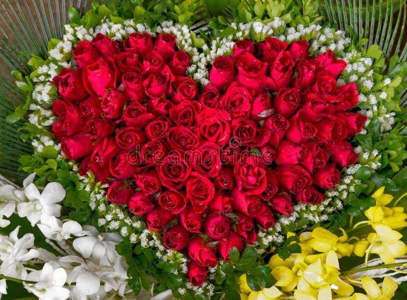 Shape Heart Red Roses Flower Background. Shape Heart Red Roses petals Flower Background stock photo