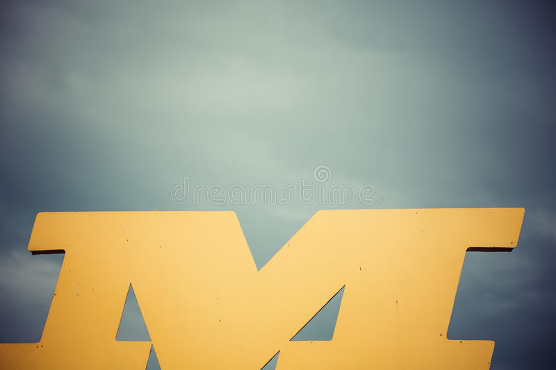 Shape of letter m in front of heavy sky stock photos