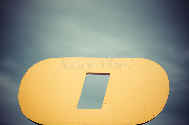 Shape of letter o in front of heavy sky royalty free stock photos