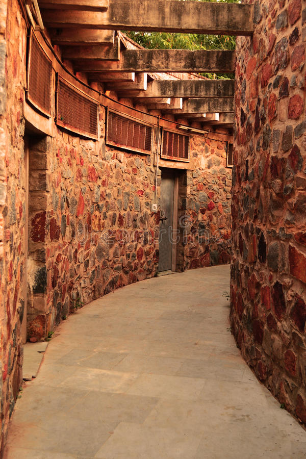 We shape our buildings, thereafter they shape us -Winston Churchil. A circular corridor, behind the open air auditorium in the Garden of Five Senses- Delhi royalty free stock photos