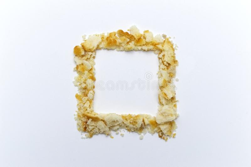 The shape of a square lined with crumbs from cookies. Copy space. royalty free stock photography