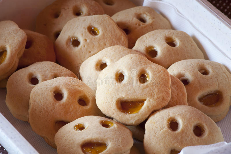 Shaped cookies smiling face. Smile biscuits with jam. royalty free stock image