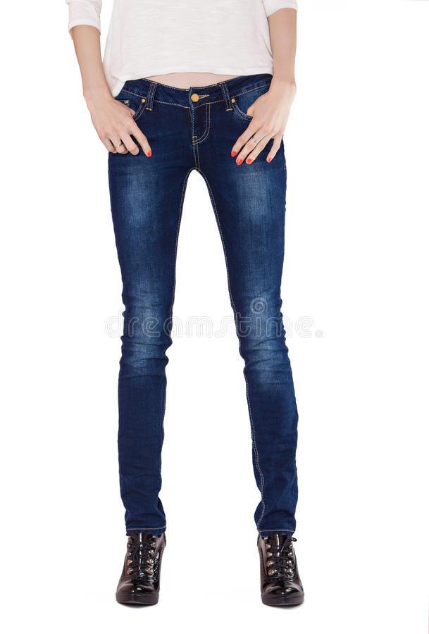 Free Shapely Female Legs Dressed In Dark Blue Jeans Royalty Free Stock Photo - 38732615