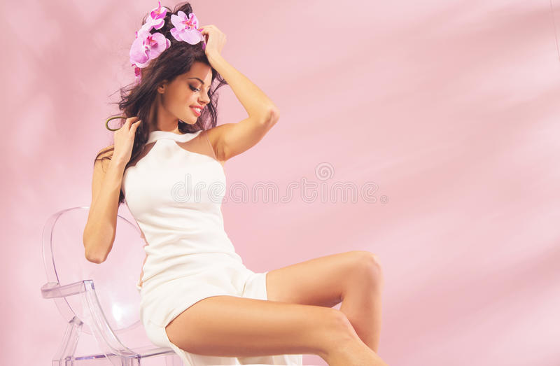 Shapely girl with flowers in her hair royalty free stock photos