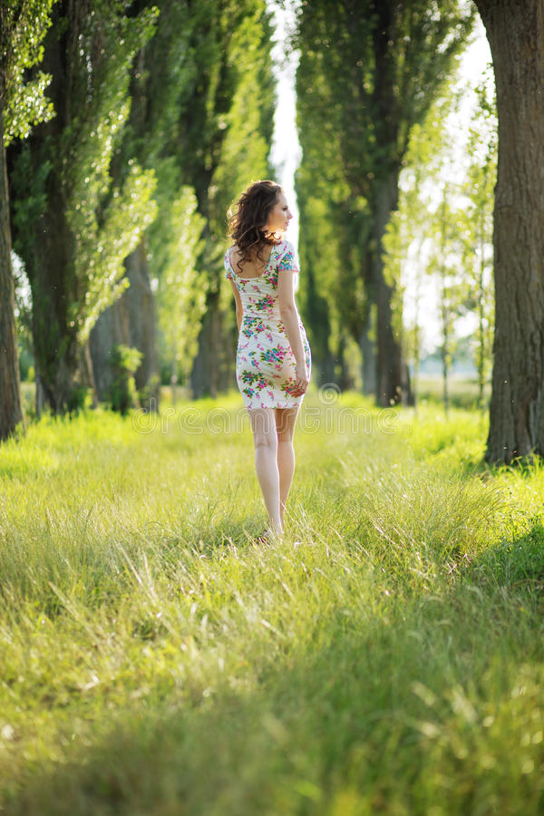 Shapely pregnant woman in the park royalty free stock photo