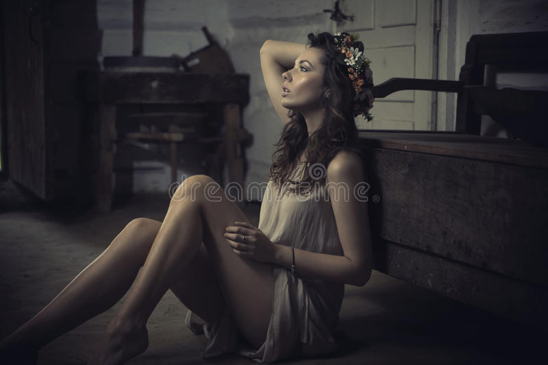 Shapely young brunette in old interior royalty free stock image