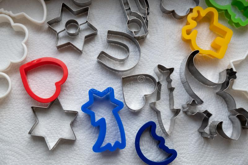 Shapes to cut out for dough to bake cookies in the Christmas season royalty free stock photo