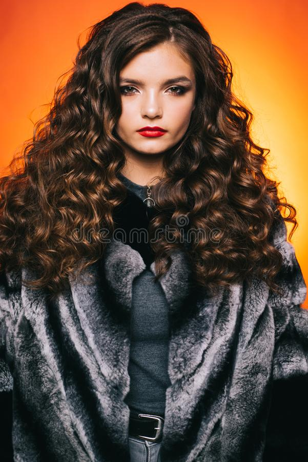 Shaping curly hair. Young woman with long locks of hair. Pretty girl with curly hairstyle. Teenage girl with stylish. Wavy hairstyle. Healthy hair care habits royalty free stock photo
