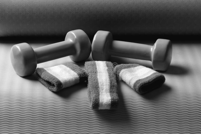 Shaping and fitness equipment. Dumbbells made of green plastic royalty free stock photography