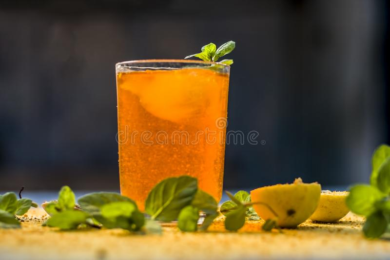 Sharbat of orange with black pepper powder,mint leaves,and a pinch of slat on silver wooden surface royalty free stock images