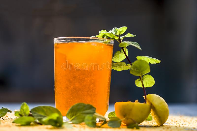Sharbat of orange with black pepper powder,mint leaves,and a pinch of slat on silver wooden surface royalty free stock photography