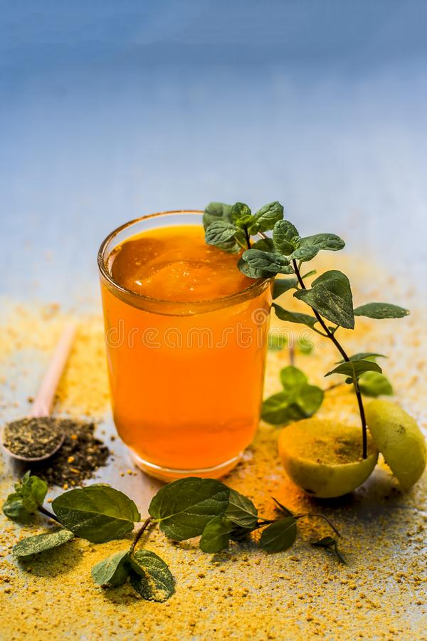 Sharbat of orange with black pepper powder,mint leaves,and a pinch of slat on silver wooden surface royalty free stock photos