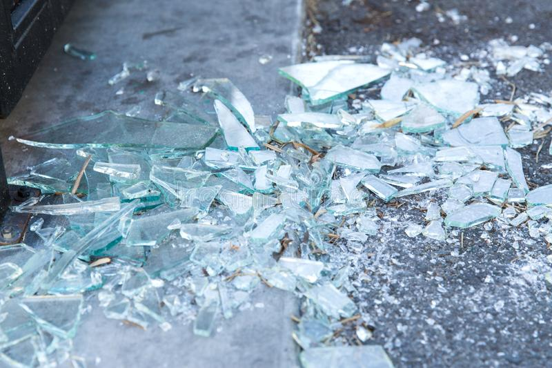 Shards of broken glass on floor stock image