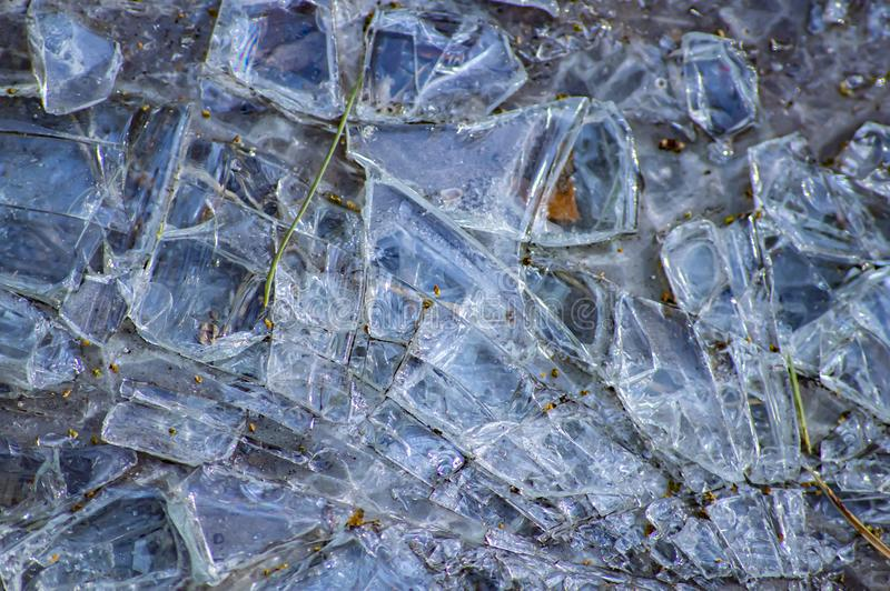 Shards of broken glass on the ground stock image