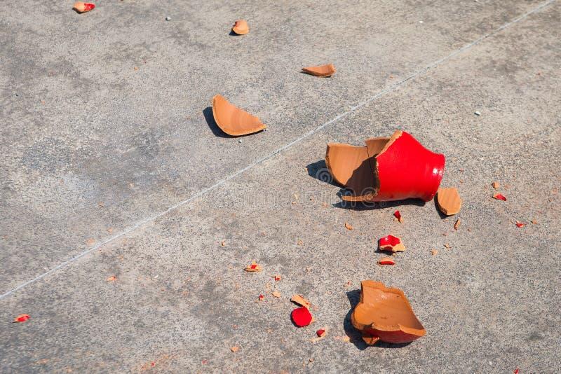 Shards of broken red clay pot royalty free stock photos