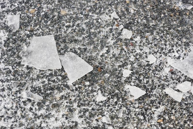 Shards of ice on the stone texture background. The puzzle of the various pieces of ice. cold in human relations psychology royalty free stock image