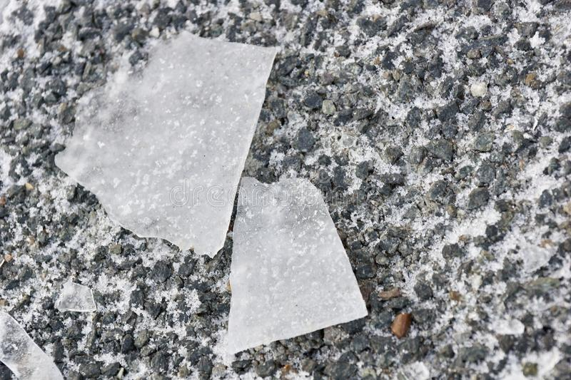 Shards of ice on the stone texture background. The two halves of fate on the cold stone ground but the snow and ice royalty free stock images