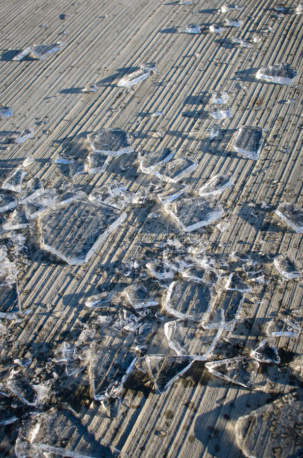 Shards of smashed ice. On the floor royalty free stock images