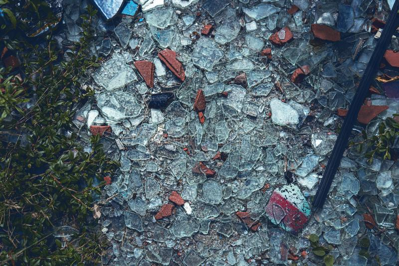 Shards of smashed roof tiles and glass stock images