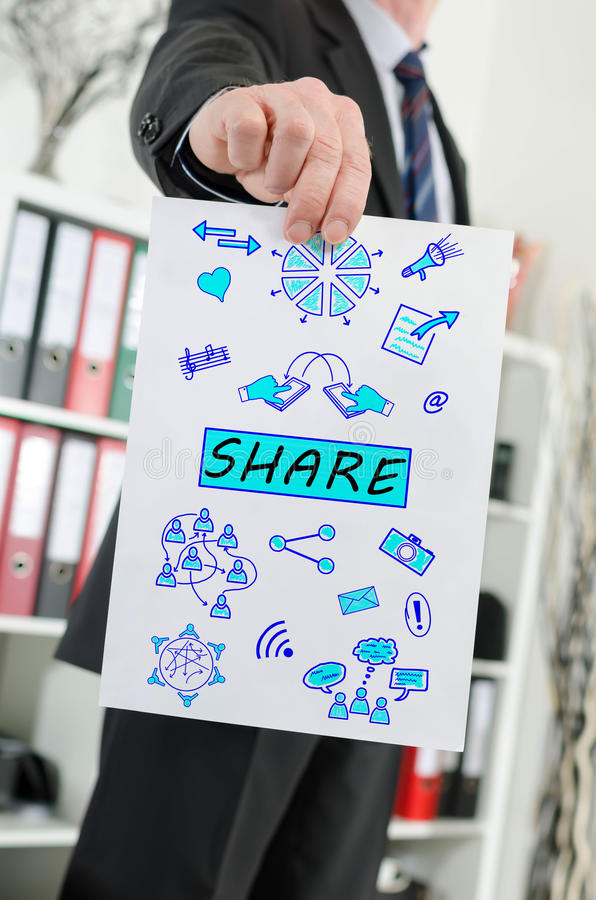 Share concept shown by a businessman. Paper showing share concept held by a businessman royalty free stock images