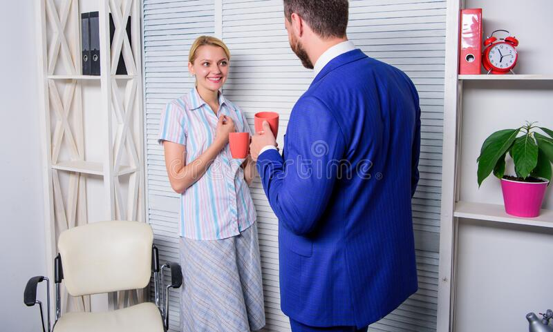 Share gossip with colleague. Fresh office news. Interesting conversation. Bearded man and woman talking. Couple stock photo