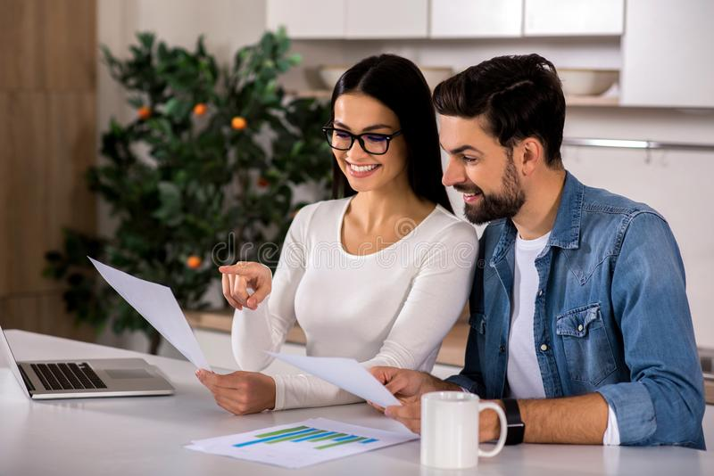 Positive couple planning their family business stock images