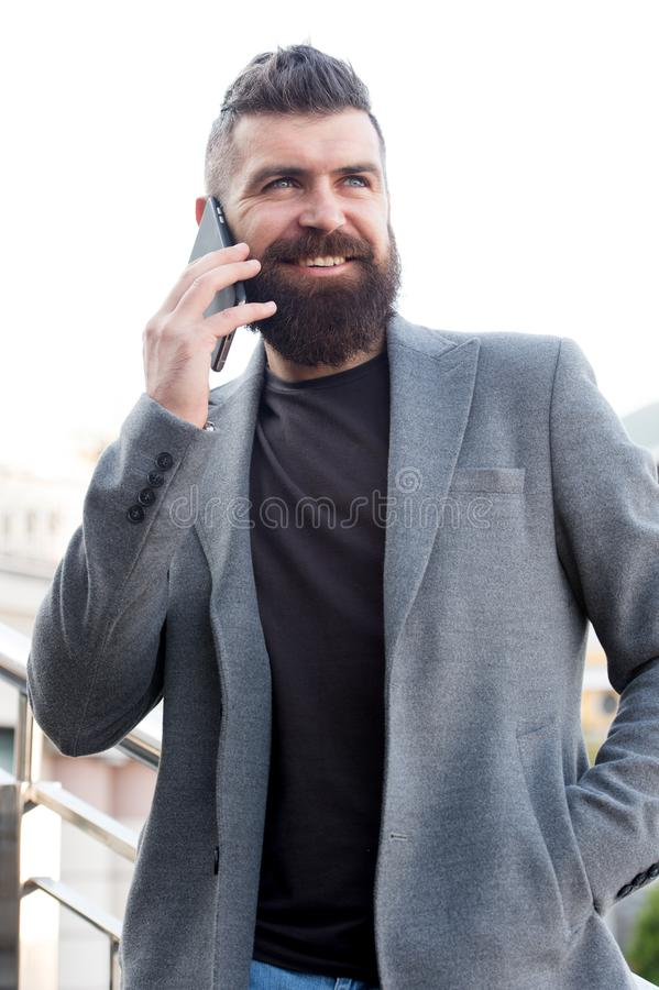 Share information by verbal communication. Bearded man has business talks on smartphone. Business communication skills royalty free stock images