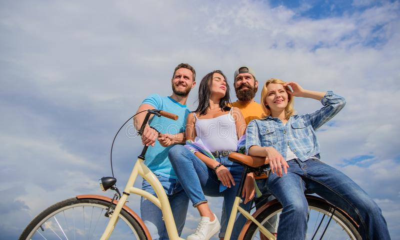 Share or rental bike service. Company stylish young people spend leisure outdoors sky background. Bicycle as best friend stock photo