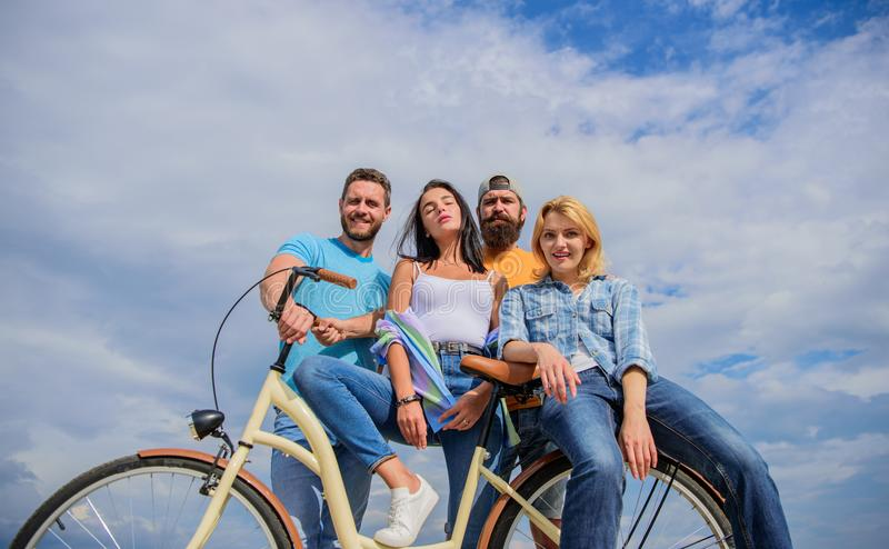 Share or rental bike service. Cycling modernity and national culture. Company stylish young people spend leisure. Outdoors sky background. Group friends hang stock photography