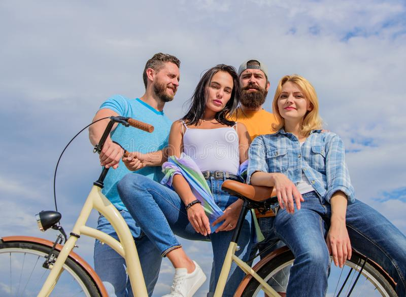Share or rental bike service. Group friends hang out with bicycle. Bicycle as best friend. Cycling modernity and. National culture. Company stylish young people royalty free stock photography