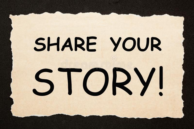 Share Your Story. Text on old torn paper on black background. Business concept stock image