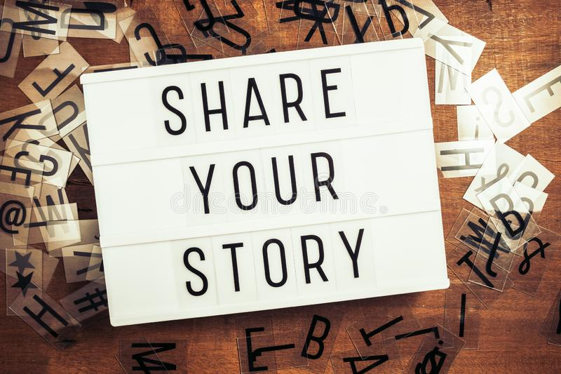 Share Your Story Text on Lightbox stock image