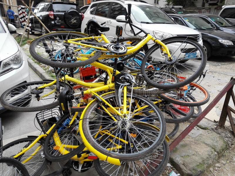 Shared bikes are stacked in a pile stock photography