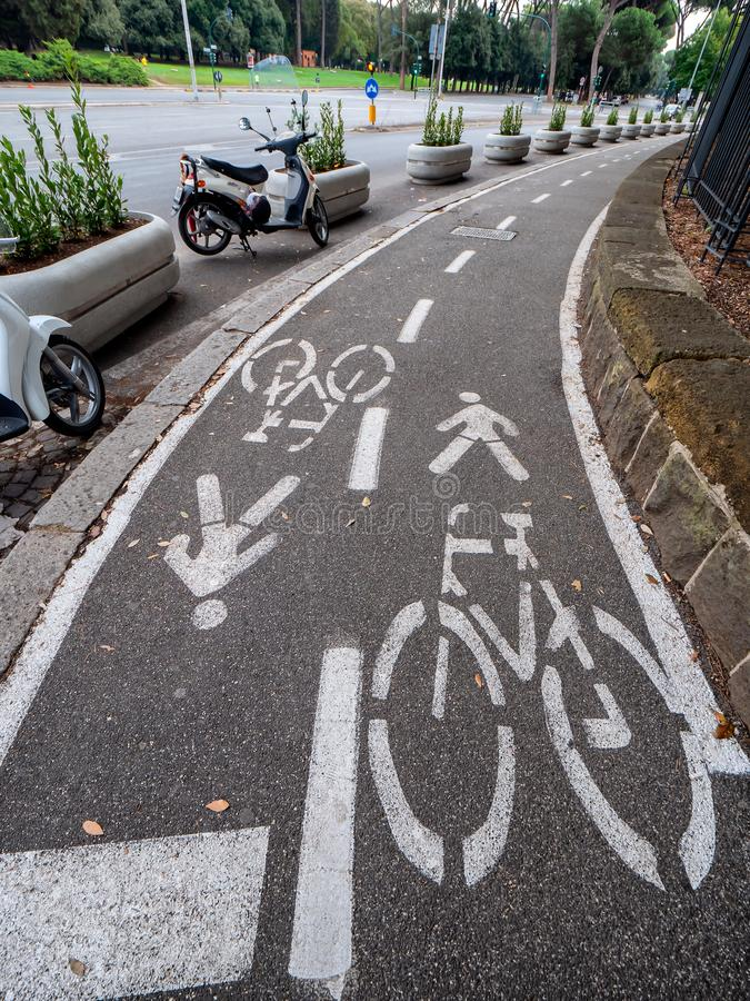 Shared pedestrian an bicycle road in Rome, Italy stock photography