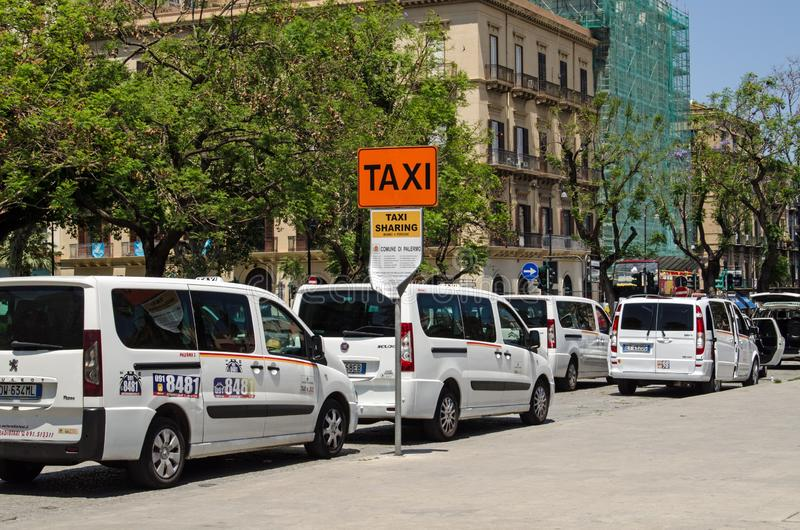 Shared taxi rank, Palermo, Sicily. PALERMO, ITALY - JUNE 18, 2018: Taxi rank for service or shared taxis in Piazza Castelnuovo, Palermo, Sicily royalty free stock photo